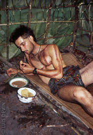Luis Devin during a meal in the Baka Pygmy initiation hut