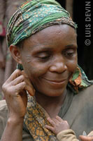 Pygmy woman with facial scarifications and a scarf