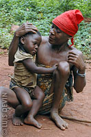 Pygmy grandmother with granddaughter in a rainforest camp