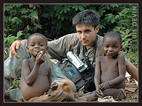 Luis Devin with Baka Pygmies in the rainforest of Cameroon