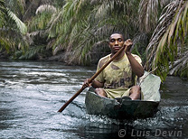 Pygmy pirogue on a river (Baka Pygmies, Gabon)